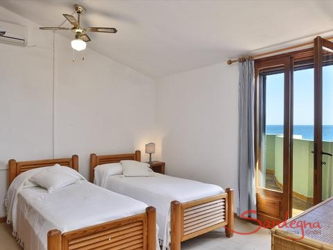 Bedroom 1 with single beds and sea view, 2nd floor