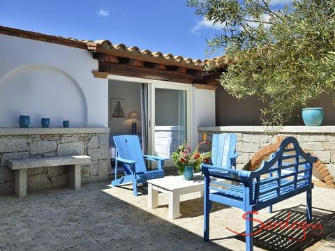 Typical Sardinian courtyard with wooden garden furniture