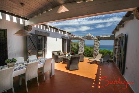 Covered dining area with sea view
