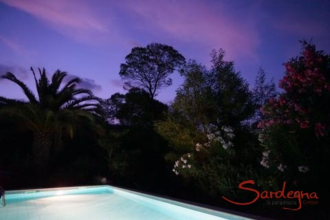 Pink clouds in the evening sky over the private pool