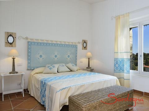 Bedroom 1 with double sized bed and sardinian decoration