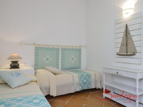 Bedroom 2 with two single beds and sardinian decoration