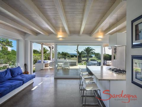Modern dining and living room with a direct sea view