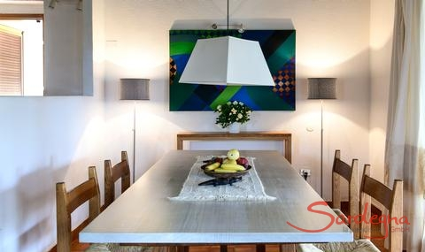 Dining table with light wooden surface