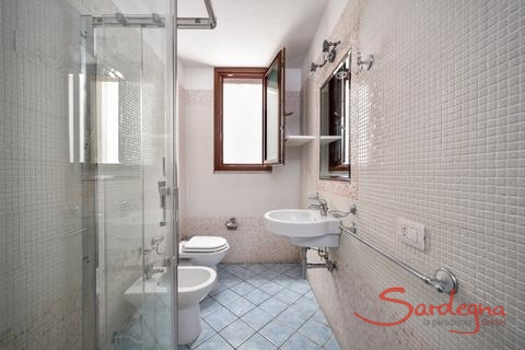 Bathroom with shower and bidet