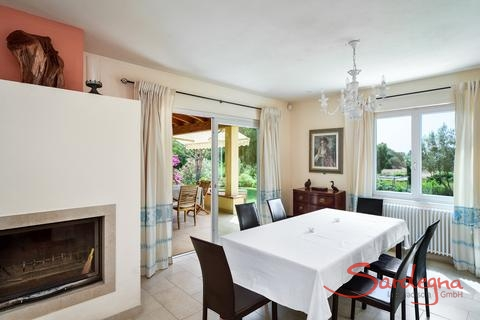 Dining area with chimney and terrace access