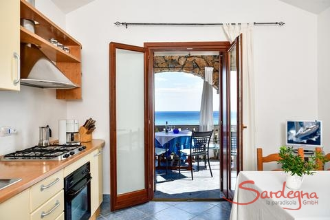 Kitchen with terrace access and sea view