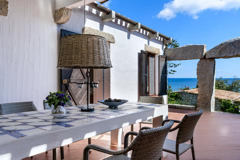 Beautiful terrace with dining table and sea view