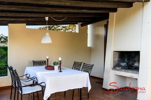 Terrace with dining table and outdoor chimney