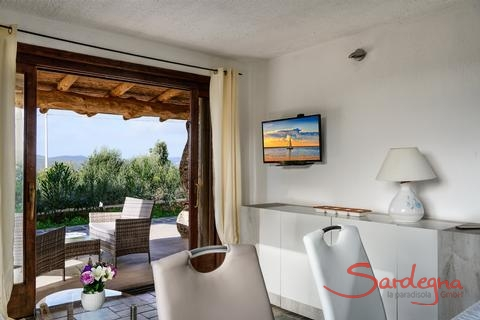 Villa Oleandro | Living room with large window door to the terrace