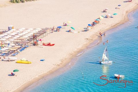 White, sandy beach with umbrellas and sundbeds for rent or free, Torresalinas
