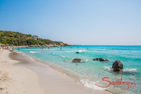 Simius Beach with turqoise shimmering sea and peple bathing in it, 26 km. away