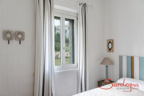 Badroom 2 with two single beds and window with garden view