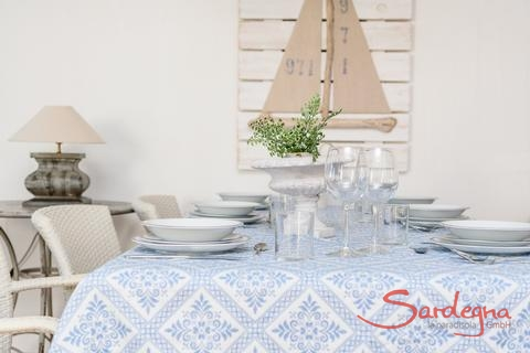 Dining table set with fine dishes, ready for eating