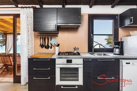 Kitchen with dishwasher, oven, gas stove and sea view