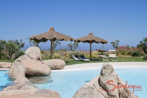 Pool with ombrellas and sun loungers